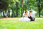Wedding couple in a grass — Stock Photo