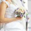 Bride holding wedding bouquet — Stock Photo #12074050