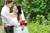 Portrait of happy wedding couple — Stock Photo
