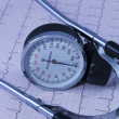 Medical stethoscope lying on ECG diagram — Stock Photo