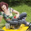 Smilling women oiling lawn mower — Stock Photo #11090766