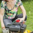 Smilling women oiling lawn mover — Stock Photo #11090830
