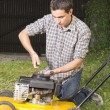 Repairing yellow lawn mover — Stock Photo #11341832