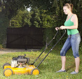 Cute girl moving the grass — Stock Photo