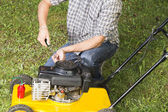 Man repairing yellow lawn mower Close up — Fotografia Stock