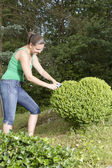 Słodkie dziewczyny, cięcia i przycinania pole drzewa serca — Zdjęcie stockowe