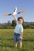 Boy preparing to launch RC plane — Stock Photo