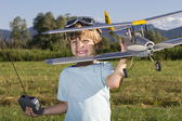 Very happy young boy with RC RC plane — Stock Photo