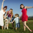 Girlfriends and little boy enjoying sunny summer afternoon outdoors — Stock Photo