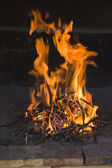 Fire flames in traditional fireside — Stock Photo