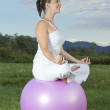 Cute woman working out with a ball — Stock Photo #11728155