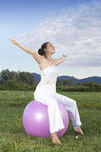 Cute woman working out with a ball — Stock Photo