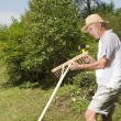 Repairing wooden rake in the garden — Stock Photo