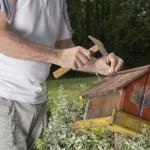 Man fixing old bird house-closeup — Stock Photo