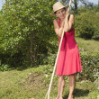 Stock Photo: Womresting whilst raking garden