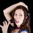 Young woman with microphone — Stockfoto