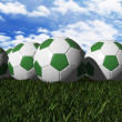 Green soccer ball on green grass — Stock Photo #10923155