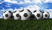Soccer ball on a green grass — Stock Photo