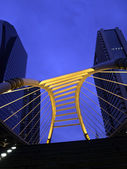 Pubic skywalk at bangkok downtown square night in business zone — Stock Photo