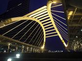 Pubic skywalk at bangkok at night in business zone — Stock Photo