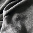 Grey towel terry cloth — Stock Photo