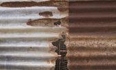 Old corrugated iron fence — Stock Photo