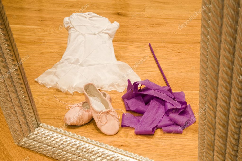 Ballet tutu, shoes and ribbon viewed through a mirror — Stock Photo #11406596