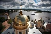 Golden cupola and monastery — Stock Photo