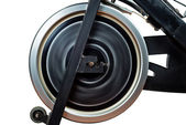 Aged Spinning Bike Flywheel Rotating. Front detail. — Stock Photo