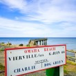 Stock Photo: OmahBeach World War Normandy location signboard Vierville sur