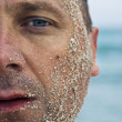 Half face covered with sand — Stock Photo