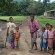 Family in village Papua New Guinea — Stock Photo