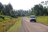 4WD car on gravel road Papua New Guinea — Stock Photo