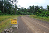 Road sign on haulage road in Papua New Guinea — Stock Photo