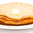 Golden pancakes with butter — Stock Photo