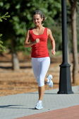 Young woman exercising in the park in summer — Foto de Stock