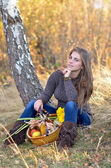 Young woman holding vegetables basket outdoor — Stock Photo