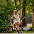 Little girl riding a bicycle. — Stock Photo