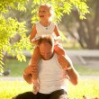 A young father and daughter in the park. — Stockfoto