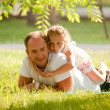Young father and daughter in park. — Stock Photo #11572120