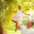 A young father and daughter in the park. — Stock Photo
