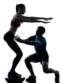 Coach man woman exercising squats on bosu — Stock Photo