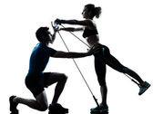 Man woman exercising gymstick workout fitness — Stock Photo