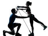 Man woman exercising gymstick workout fitness — Stock Photo