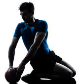 Man exercising workout holding fitness ball posture — 图库照片