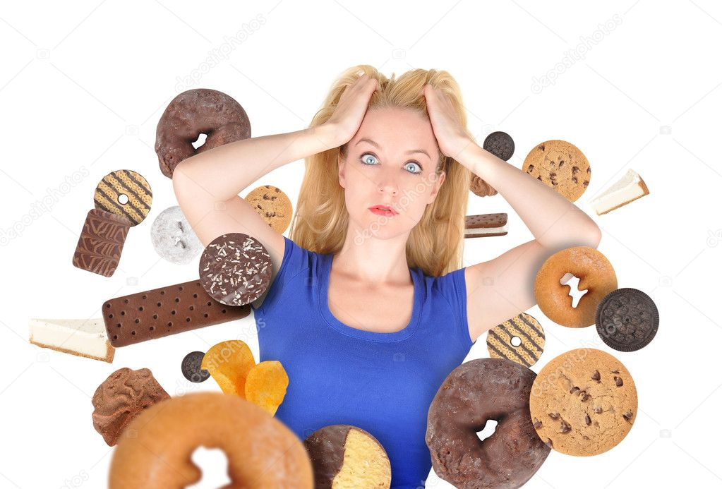A woman has sweet food snacks around her on a white background. She has fear and there are donuts and cookies. Use it for a health or diet concept.  — Stock Photo #10895315