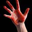 Scary Bloody Hand Reaching on Black - Stock Photo