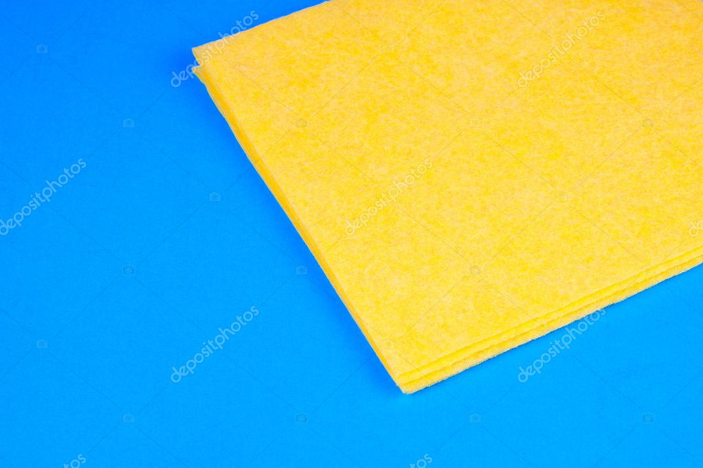 Yellow microfiber kitchen duster on blue background — Stock Photo #10743670