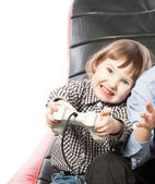 Cute young girl playing videogame — Stock Photo