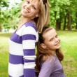 Cute mother and daughter - Stock Photo
